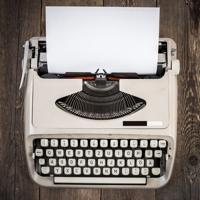Old vintage typewriter on wooden table.