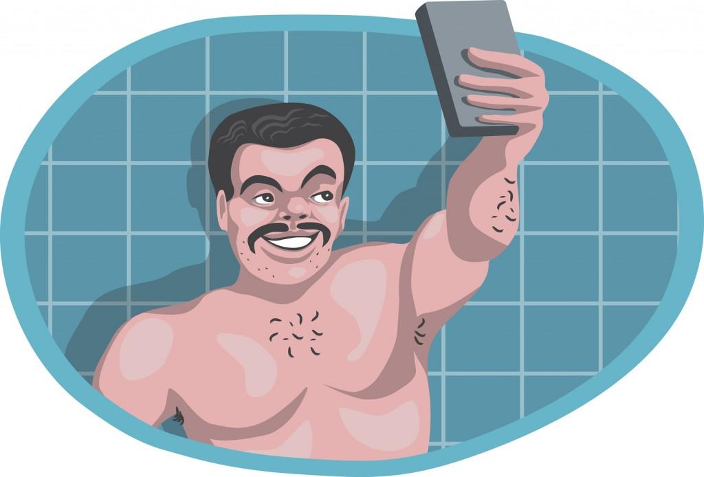 Naked man taking selfie